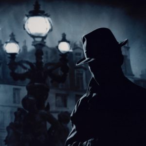 SILHOUETTE OF A DETECTIVE OUT AT NIGHT